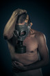 Safety concept, nude man with gas mask