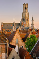 Sunset in Bruges. View on the city and Belfry from the roof.