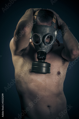 Toxic concept, nude man with gas mask