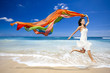 Happy woman jumping on beach