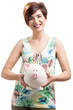 Happy woman with a piggy bank