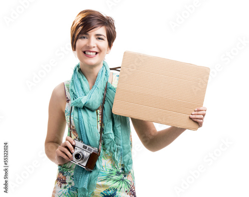 Woman with a vintage camera and a cardboard