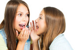 Gossip. Two Teenage Girls Speaking and Sharing Secrets