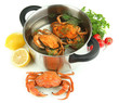 Composition with boiled crabs, pan and vegetables isolated