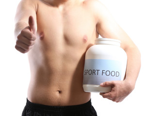 Handsome young muscular sportsman with protein food, isolated