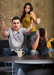 Hispanic Family Watching TV