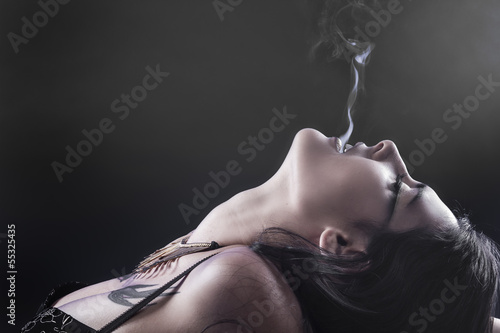 Smoking, tattoed woman with smoke flame