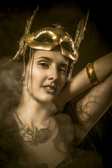 Queen, sensual woman with golden mask, ancient goddess