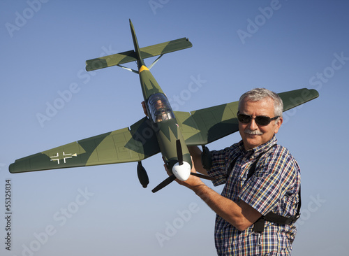 Friendly senior RC modeller and his new plane model