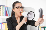 Woman with megaphone. Angry young businesswoman shouting at mega