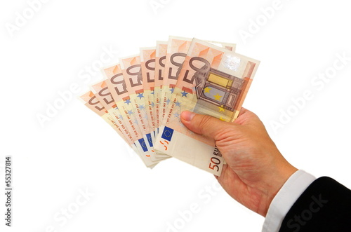 business man's hand showing cash