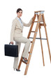Businesswoman climbing career ladder with briefcase and looking