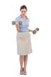 Tough businesswoman lifting dumbbells looking at camera