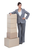 Smiling businesswoman with cardboard boxes