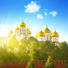 Golden domes in the Moscow Kremlin and sunlight.