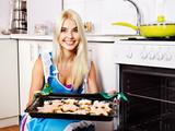 girl baking cookies in the oven