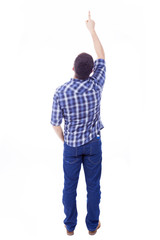 Back view of young man pointing up, isolated over white backgrou
