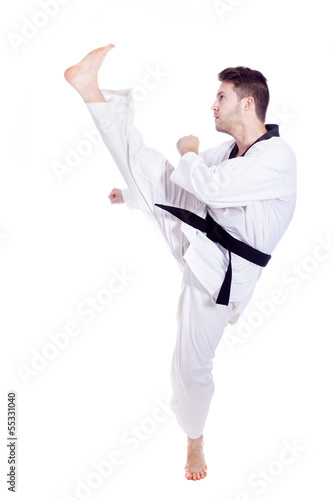 Young man in kimono training martial arts, isolated over white b