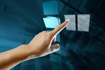a woman hand select and open a folder on a digital screen