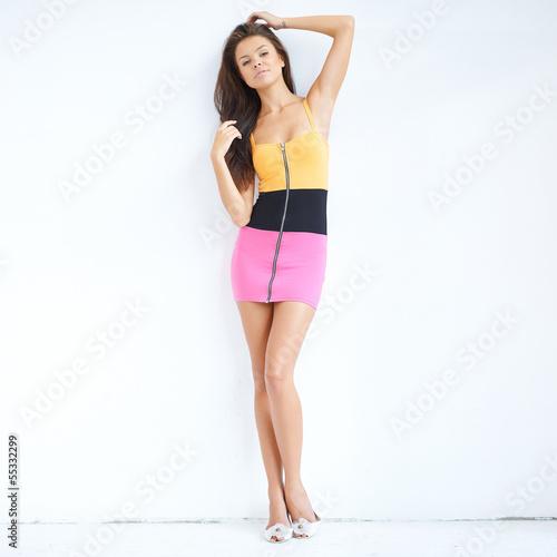 Full body shot of sensual brunette in miniskirt