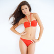 Cute girl in red bikini posing isolated