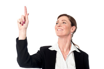 Attractive business lady pointing