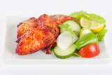 Hot Wings - Spicy and hot chicken wings served with salad.