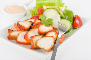 Chicken Tikka - Spicy marinated chicken with salad and dip.