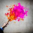 Human hand holding paint brush