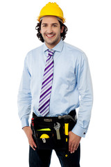 Smiling male architect wearing tool belt