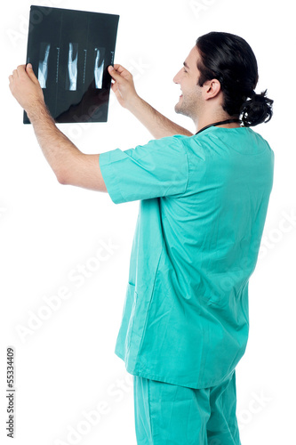 Doctor looking at scanned x-ray report