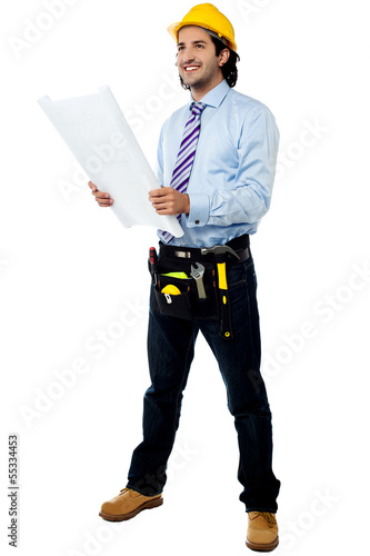 Male architect with construction plan