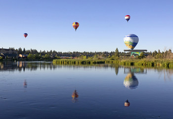 Many hot air balloons over the Deschutes River, Bend, Oregon
