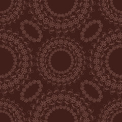 Seamless lace pattern on a brown background