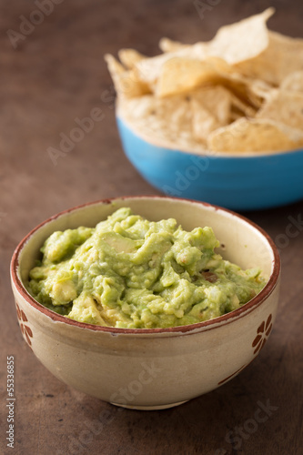 Bowl of guacamole on table