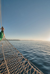 Overlooking the top deck of a sailboat while cruising on the Gre