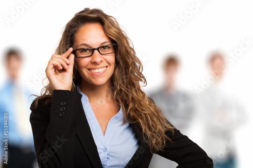Woman holding her eyeglasses