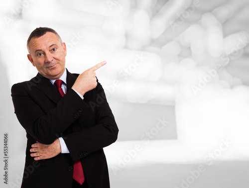 Businessman pointing his finger to the copy space