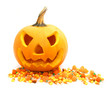 Jack o Lantern with scattered Halloween candy