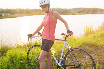 Cute portrait of young serene caucasian female cyclist having a