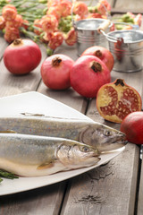Two raw, fresh rainbow trouts among vegetables. Idea of healthy