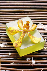 Orchid on nature soap on mat