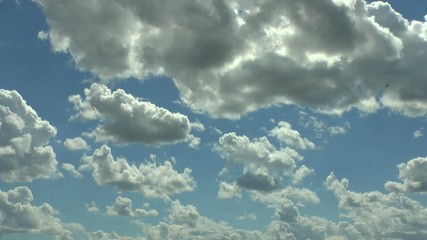 Movement of clouds in a sunny day