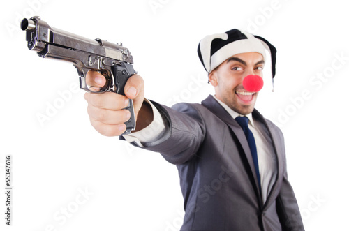 Businessman clown with gun isolated on white