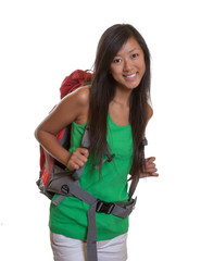 Laughing asian backpacker