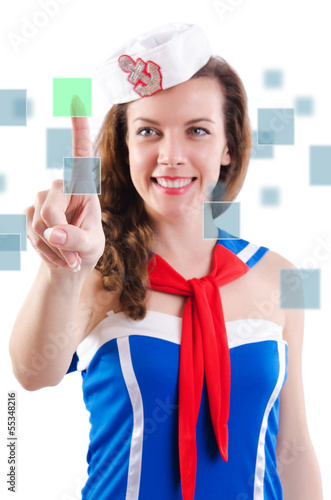 Young woman sailorpressing virtual buttons