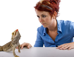 Spikey-haired girl staring at spikey bearded dragon reptile