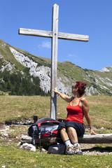Woman touching wooden cross