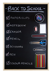 School supplies over blackboard background