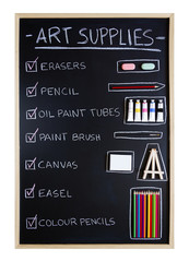 Art supplies over blackboard background
